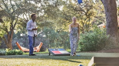 Couple Playing Outdoor Games at Four Seasons Austin