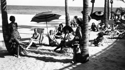 Historical photo of ladies relaxing on beach at The Surf Club, Surfside, FL